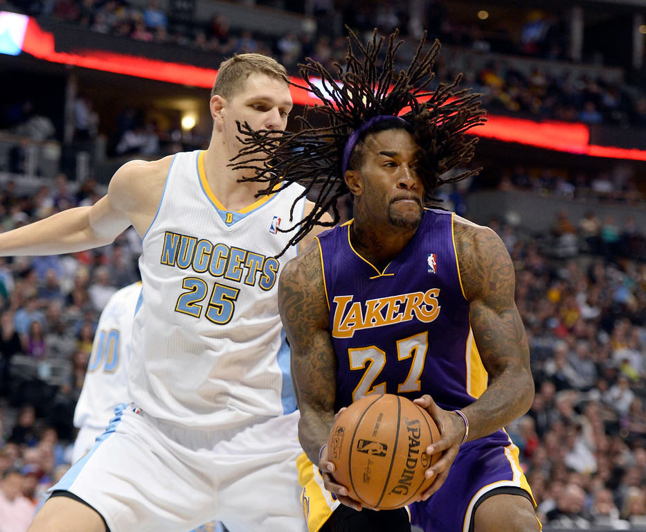 . DENVER, CO - NOVEMBER 13: Los Angeles Lakers center Jordan Hill (27) does a spin move on Denver Nuggets center Timofey Mozgov (25) as he dries to the basket during the third quarter November 13, 2013 at Pepsi Center. (Photo by John Leyba/The Denver Post)
