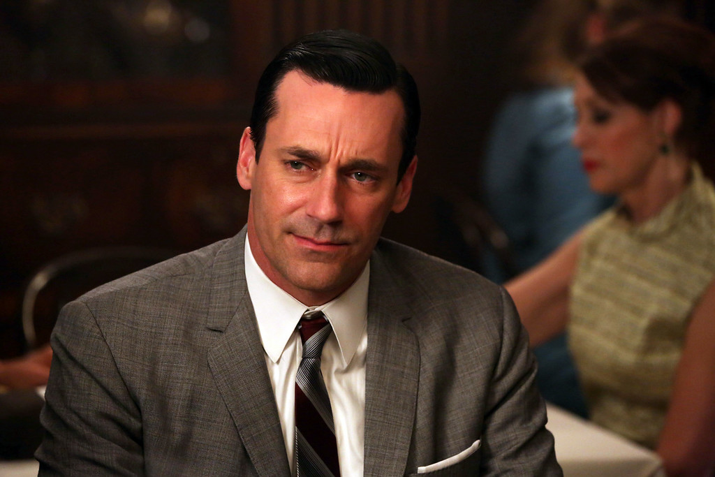 """. This TV publicity image released by AMC shows Jon Hamm as Don Draper in a scene from \""""Mad Men.\"""" Hamm was nominated for an Emmy Award for best actor in a drama series on Thursday, July 10, 2014, for his role as Don Draper. The 66th Primetime Emmy Awards will be presented Aug. 25 at the Nokia Theatre in Los Angeles.  (AP Photo/AMC, Michael Yarish)"""