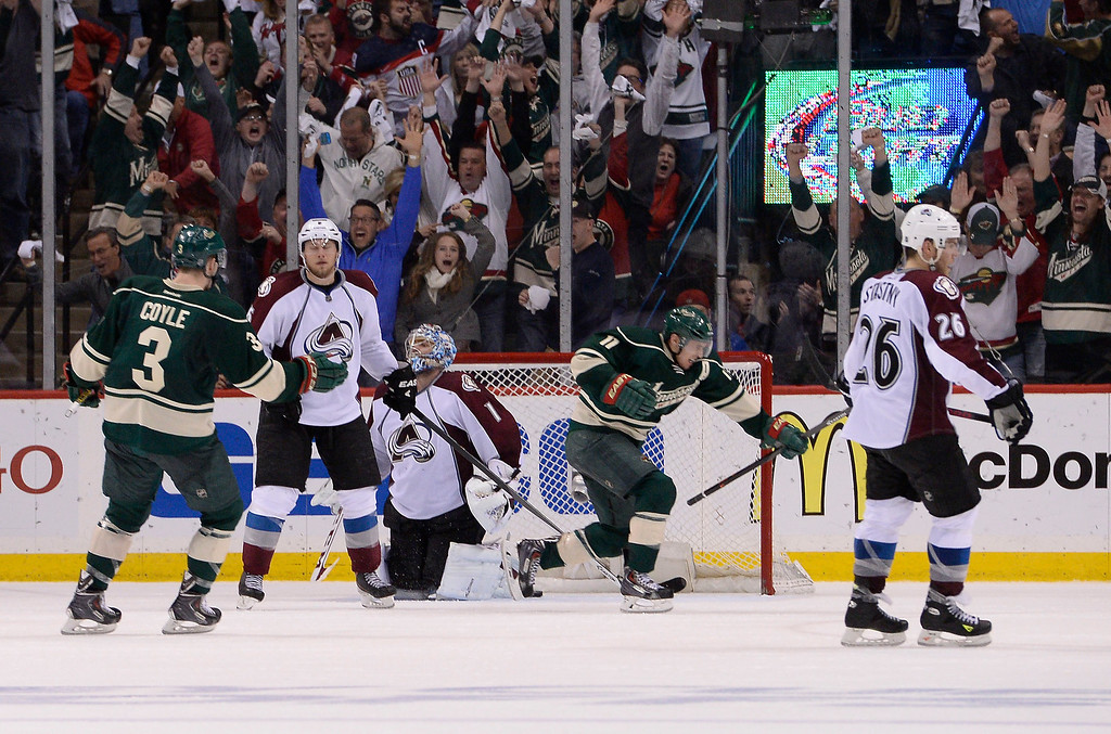. Minnesota Wild left wing Zach Parise (11) celebrates his game winning goal during the third period as Colorado Avalanche goalie Semyon Varlamov (1) looks up dejected April 28, 2014 in Game 6 of the Stanley Cup Playoffs at Xcel Energy Center.  (Photo by John Leyba/The Denver Post)