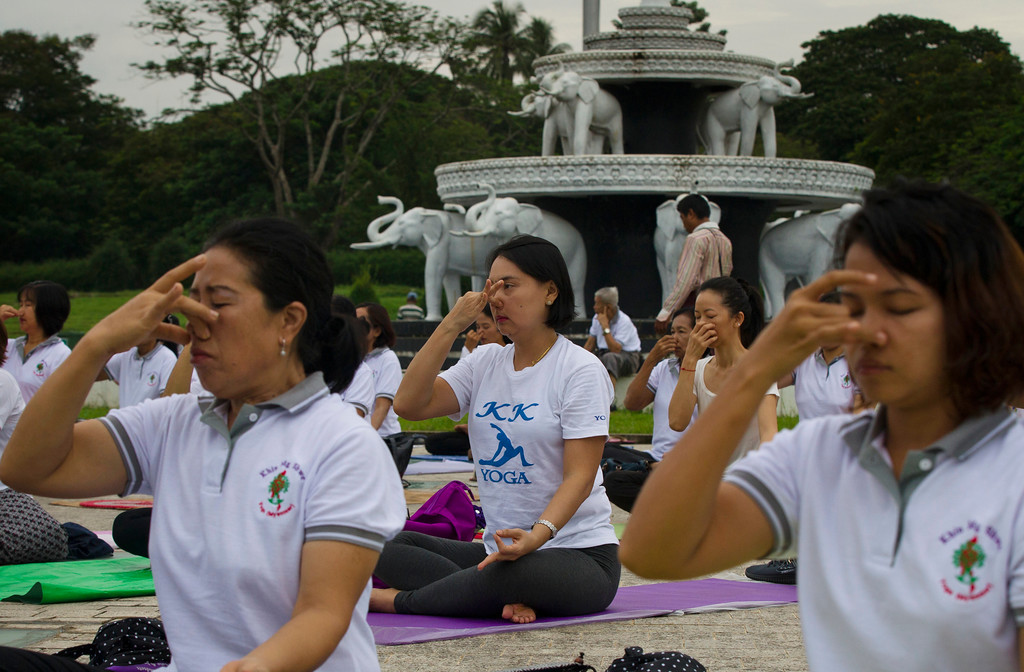. People practice yoga on International Yoga Day, in Yangon, Myanmar Wednesday, June 21, 2017. Yoga enthusiasts took part in mass yoga programs to mark International Yoga Day throughout the world. (AP Photo/Thein Zaw)