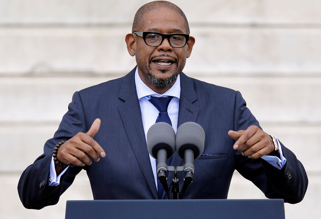 """. Entertainer Forest Whitaker speaks at the Let Freedom Ring ceremony at the Lincoln Memorial in Washington, Wednesday, Aug. 28, 2013, to commemorate the 50th anniversary of the 1963 March on Washington for Jobs and Freedom. It was 50 years ago today when Martin Luther King Jr. delivered his \""""I Have a Dream\"""" speech from the steps of the memorial. (AP Photo/Carolyn Kaster)"""