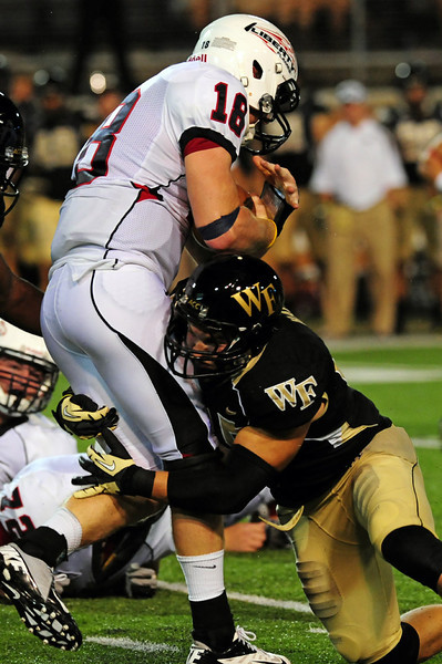 Riley Haynes tackles Hudson.jpg