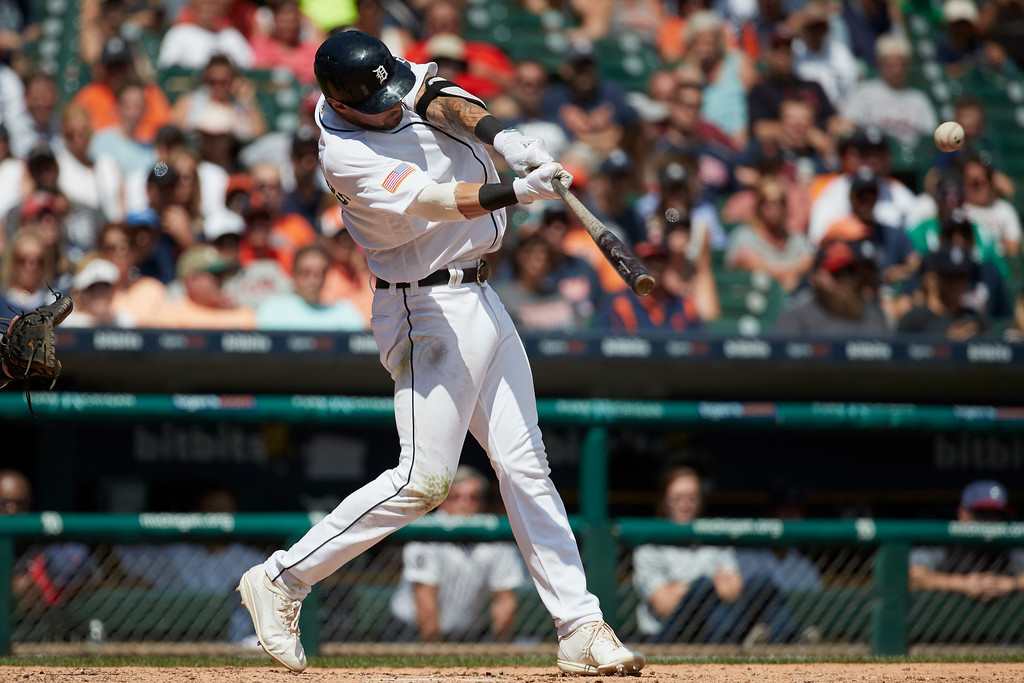 . Detroit Tigers\' Nicholas Castellanos hits an RBI triple against the Cleveland Indians during the seventh inning in the first baseball game of a doubleheader in Detroit, Saturday, July 1, 2017. (AP Photo/Rick Osentoski)