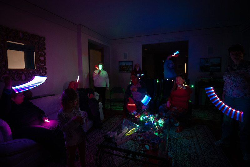 Everybody is painting with light. Room lights off, camera on a tripod and the shutter is open.