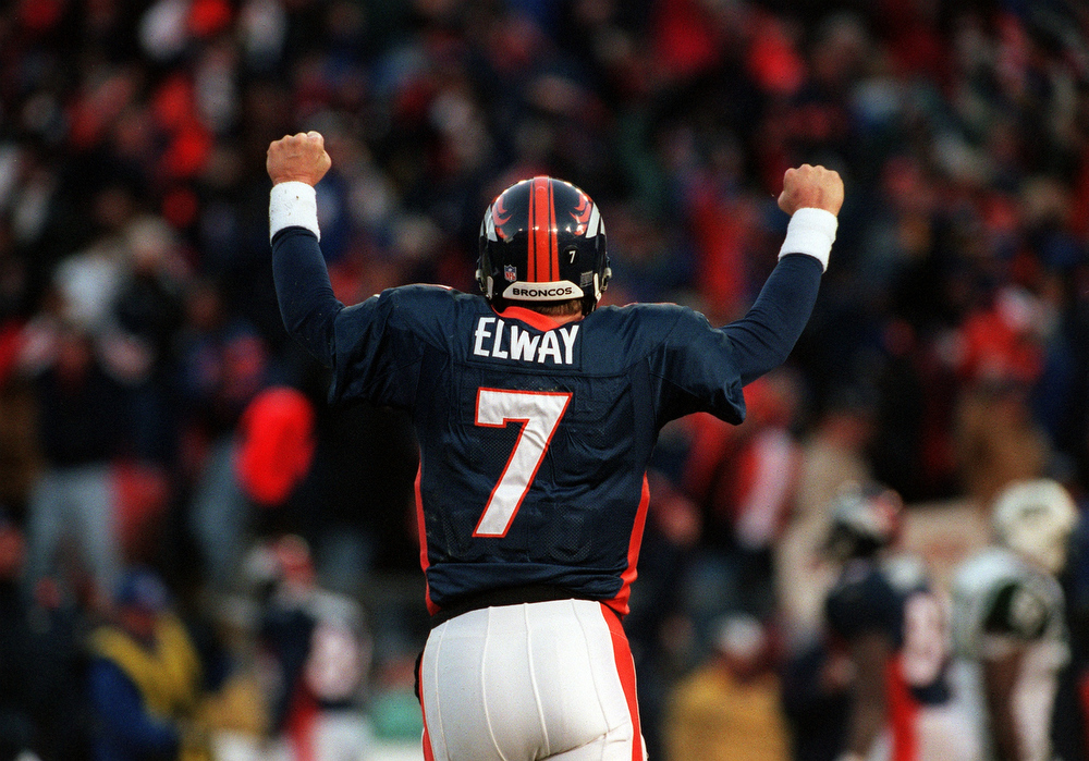 . In John Elway\'s last home game of his career, he completed only 13 of 34 passes. However, running back Terrell Davis, the NFL MVP in 1998, ran for 167 yards and a touchdown as Denver beat the Jets 23-10 in the AFC Championship game.   Denver Broncos John Elway leaves the field after a  Broncos score during the third quarter that tied the game against  the New York Jets, during the AFC Championship game. The Broncos  went on to win 23-10.  Photographer: CRAIG WALKER/THE DENVER POST