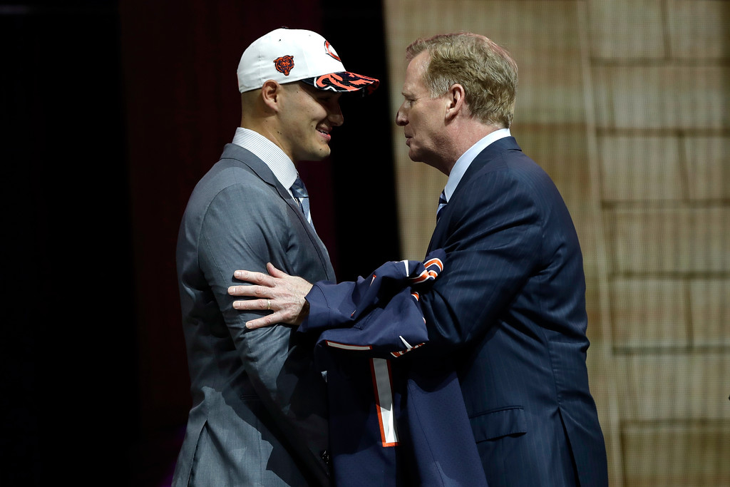 . North Carolina\'s Mitch Trubisky, left, shakes hands with NFL commissioner Roger Goodell after being selected by the Chicago Bears during the first round of the 2017 NFL football draft, Thursday, April 27, 2017, in Philadelphia. (AP Photo/Matt Rourke)