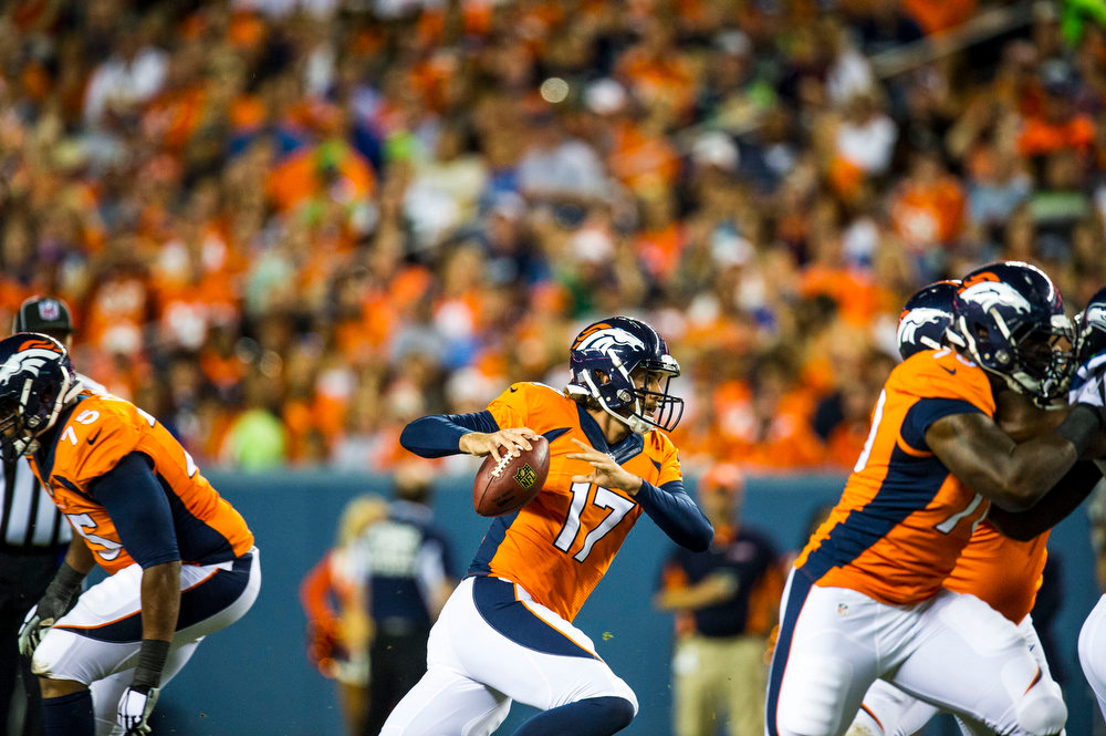 . Brock Osweiler (17) quarterback of the Denver Broncos scrambles out of the pocket during second quarter action of a preseason game between the Denver Broncos and the Seattle Seahawks at Sports Authority Field at Mile High on Thursday, August 07, 2014 in Denver, Colorado.  (Photo by Kent Nishimura/The Denver Post)