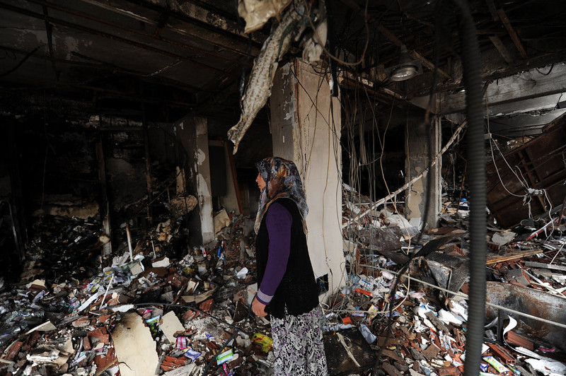 . A woman stands among the debris of a building damaged by a car bomb explosion on May 12, 2013 at Reyhanli in Hata, just a few kilometers from the main border crossing into Syria.Turkey was reeling from twin car bomb attacks which left at least 43 people dead in a town near the Syrian border, with Ankara blaming pro-Damascus groups and vowing to bring the perpetrators to justice.   BULENT KILIC/AFP/Getty Images