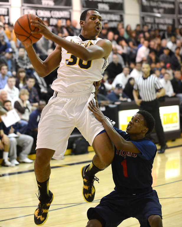. Bishop Montgomery\'s Lamond Murray Jr. (30) looks to make a pass over La Verne Lutheran\'s Tey Williams (1) in a CIF SS Division IV-AA semifinal game in Torrance Friday night. Lutheran stunned Bishop Montgomery 63-59, ending their unbeaten season. 20130222 Photo by Steve McCrank / Staff Photographer