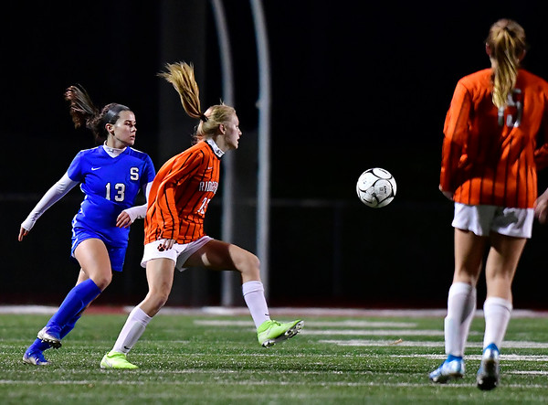 11/19/2019 Mike Orazzi | StaffrSouthington High School's Maya Wroblewski (13) and Ridgefield High Schools Allison Ouellette (23) during the Class LL Semifinal Girls Soccer match at Naugatuck High School Tuesday night. Southington advanced to the final 1-0.