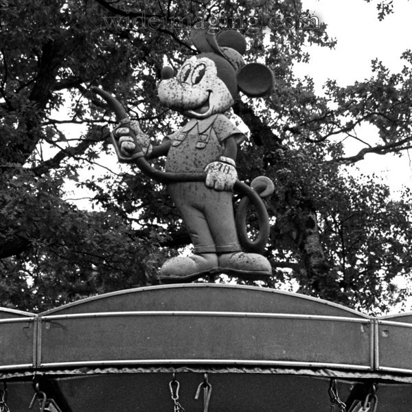 Mickey holds a gas pump atop ancient Skansen carousel, August 27, 2009.