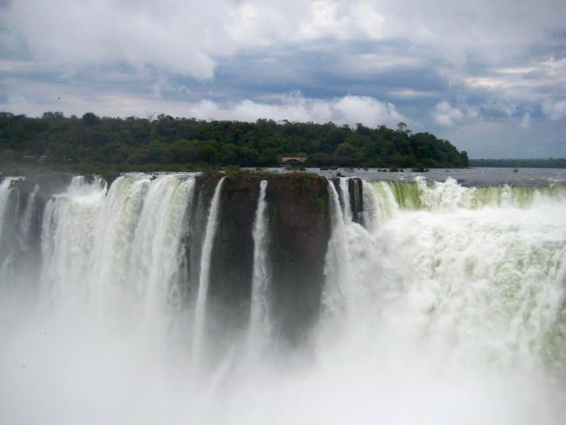 Waterfalls streaming into a river at Iguazu Falls