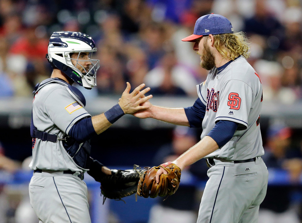 . San Diego Padres catcher Austin Hedges and relief pitcher Brandon Maurer celebrate after the Padres defeated the Cleveland Indians 1-0 in a baseball game, Tuesday, July 4, 2017, in Cleveland. (AP Photo/Tony Dejak)