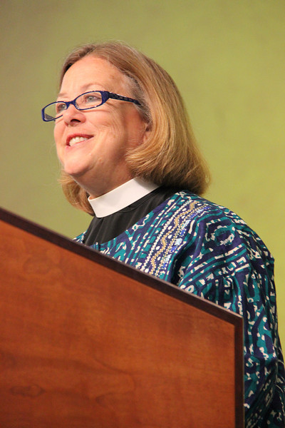 The Rev. Susan Langhauser, a member of the Church Council from Olathe, Kansas, leads the morning prayer.