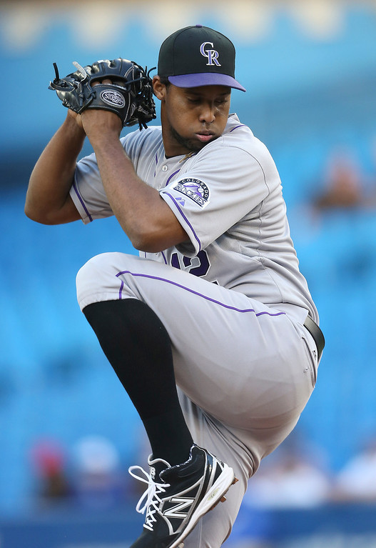 . Juan Nicasio #44 of the Colorado Rockies delivers a pitch during MLB game action against the Toronto Blue Jays on June 19, 2013 at Rogers Centre in Toronto, Ontario, Canada. (Photo by Tom Szczerbowski/Getty Images)
