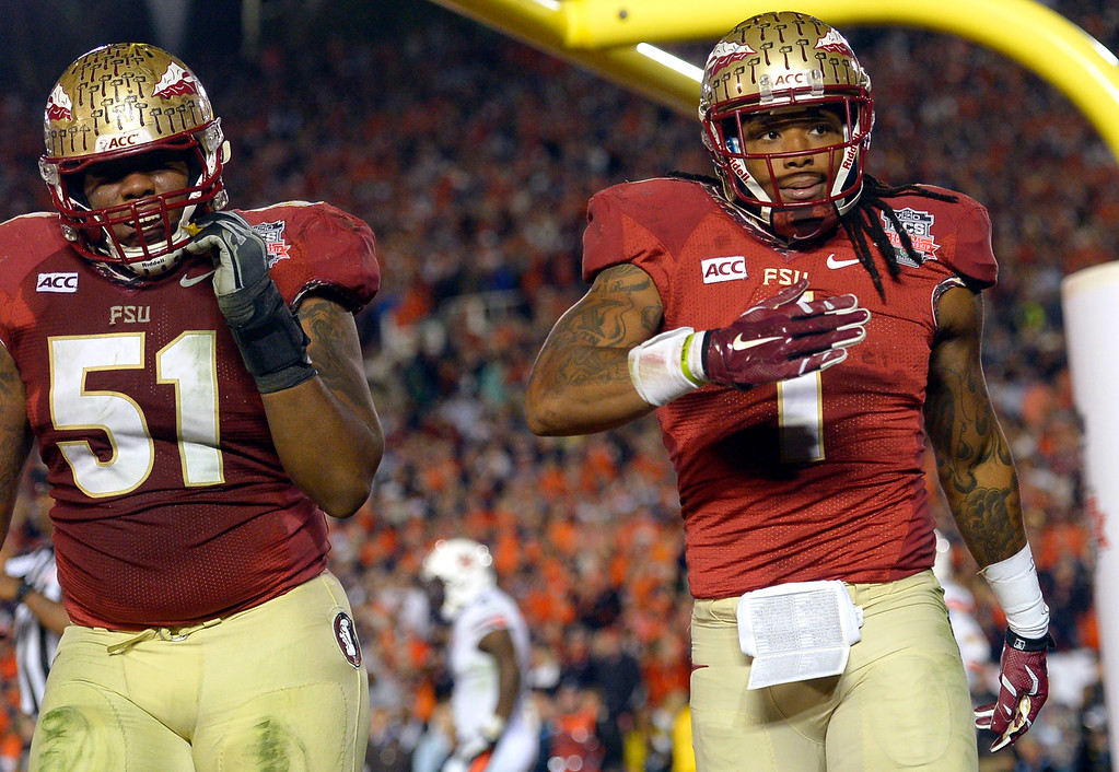 . Florida State\'s Kelvin Benjamin reacts after scoring the winning touchdown against Auburn during the 2014 Vizio BCS National Championship January 6, 2014 in Pasadena CA.  Florida State won the game 34-31.(Andy Holzman/Los Angeles Daily News)