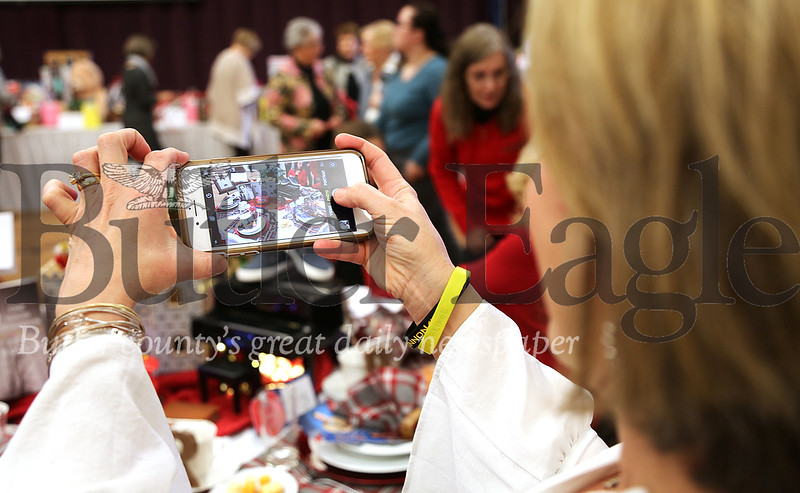 "Erin Linnon, of Meridian, is shown Sunday, Jan. 26, 2020, taking a photograph of a table centerpiece celebrating Maxwell King's ""The Good Neighbor"" during the Luncheon for Literacy sponsored by the Rotary Club of Butler PM and held in Founders Hall on Butler County Community College's main campus in Butler Township. The Luncheon for Literacy raises funds to benefit BC3's adult literacy program."