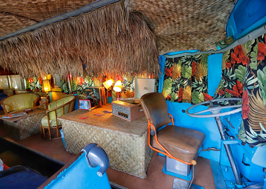 """. The interior of a 1947 Airporter bus is decorated in a 1950\'s Hawaiian theme at the Shady Dell Trailer Court, Tuesday, April 25, 2017, in Bisbee, Ariz. The \""""Tiki\"""" bus is used as a guest room at the trailer lodge in Southern Arizona compete with 50\'s island records on a vintage phonograph. (AP Photo/Matt York)"""