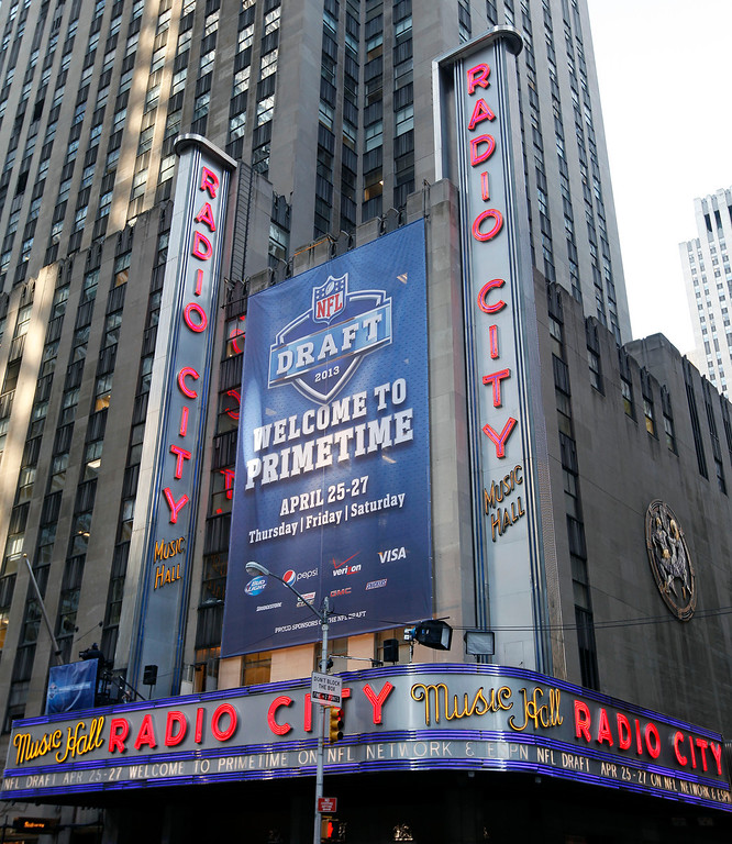 . NFL football draft signs decorate the marquee at Radio City Music Hall before the first round, Thursday, April 25, 2013, in New York. (AP Photo/Jason DeCrow)