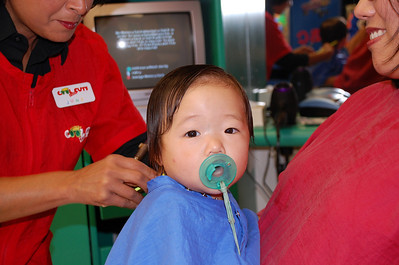 August 9, 2008 - Emily's 1st Haircut at Cool Cuts.  What a big girl!!