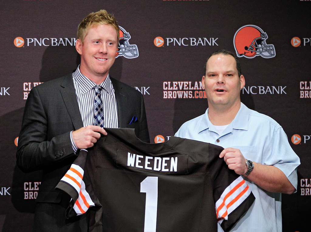 . Cleveland Browns first round pick quarterback Brandon Weeden, left, poses with general manager Tom Heckert at the NFL football team\'s headquarters in Berea, Ohio Friday, April 27, 2012. Weeden was taken with the 22nd overall pick in the 2012 NFL draft. (AP Photo/Mark Duncan)