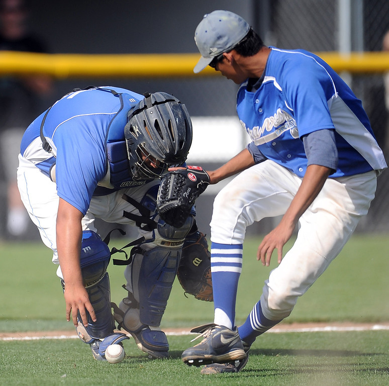 . Northview\'s Anthony Amaya (not pictured) singles as Baldwin Park starting pitcher Bernardo Flores (C) and catcher Daniel Escobedo reaches for the baseball in the fourth inning of a prep baseball game against Northview at Northview High School on Tuesday, April 23, 2012 in Covina, Calif. Northview won 8-2.    (Keith Birmingham/Pasadena Star-News)