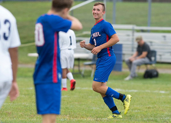 09/30/19 Wesley Bunnell | StaffrrSt. Paul boys soccer defeated Kennedy in a home game on Monday afternoon. Ethan Rembish (3) smiles after scoring a second half goal.