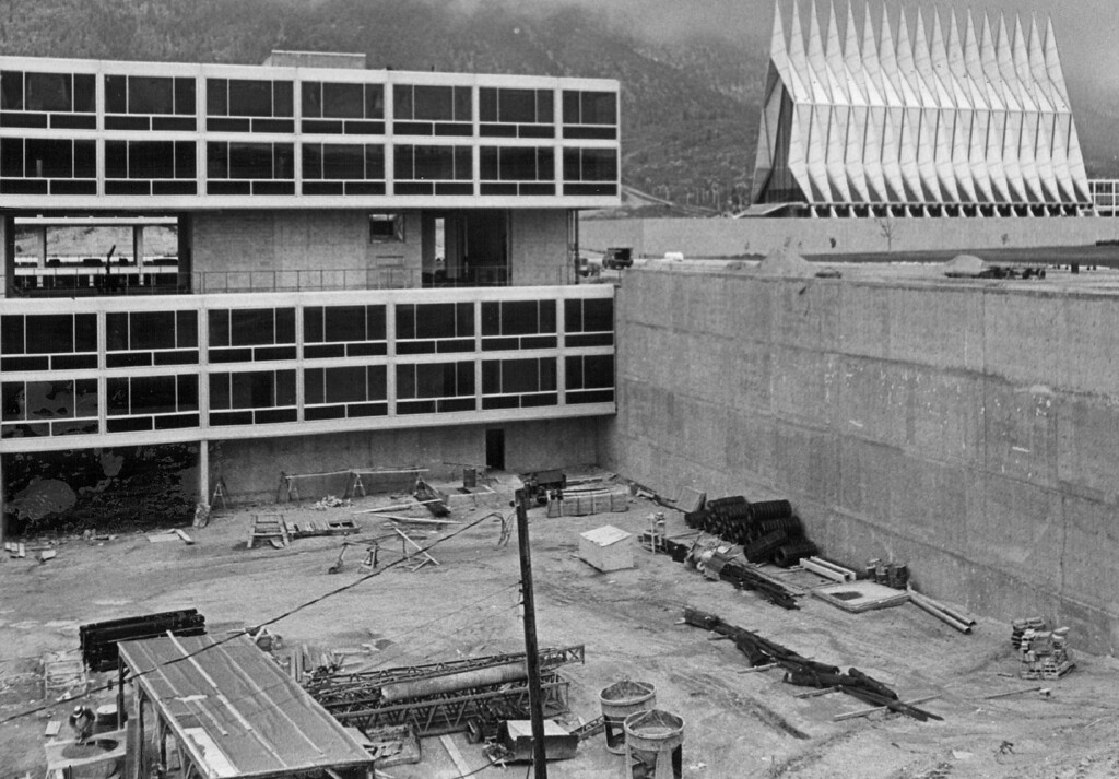 . U.S. - Air Force Academy (Under Construction) The planned six-story dormitory for cadets will have a three-story section near its center point to permit an unobstructed view of academy chapel from other parts of the reservation. 1966. The Denver Post Library Archive Credit: Denver Post
