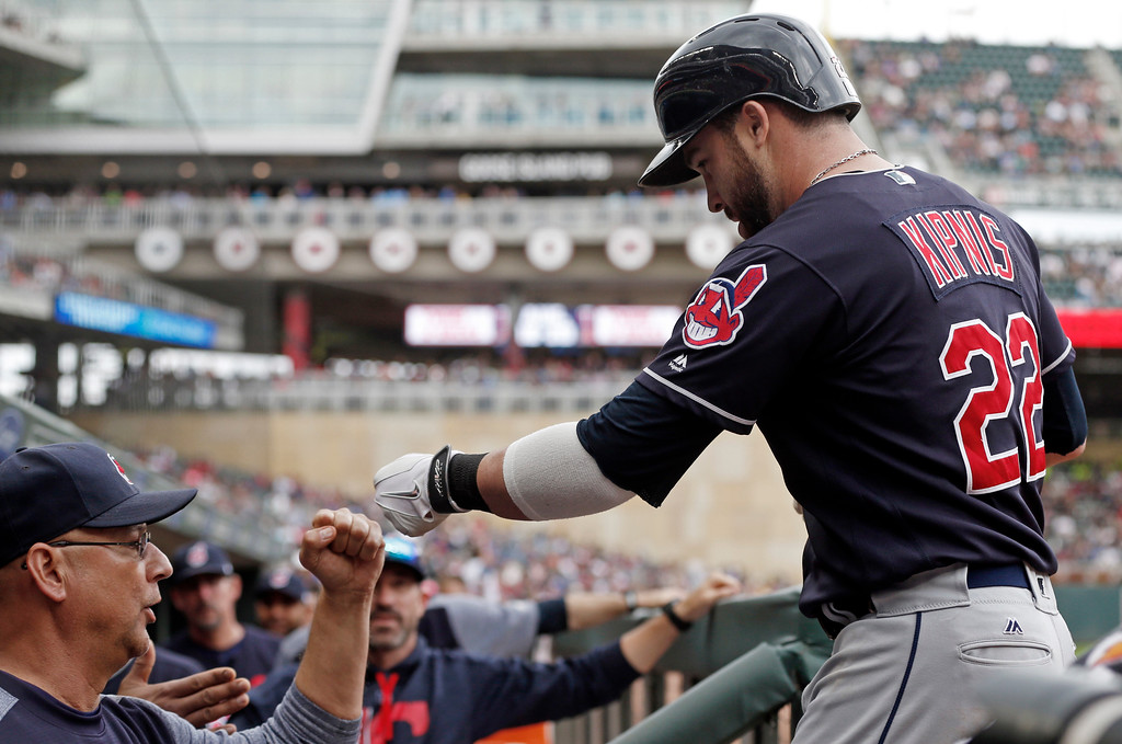 . Cleveland Indians\' Jason Kipnis, right, is congratulated manager Terry Francona after hitting a solo home off Minnesota Twins relief pitcher Ryan Pressly in the eighth inning of the first baseball game of a doubleheader, Thursday, Aug. 17, 2017, in Minneapolis. The Indians won 9-3. (AP Photo/Jim Mone)