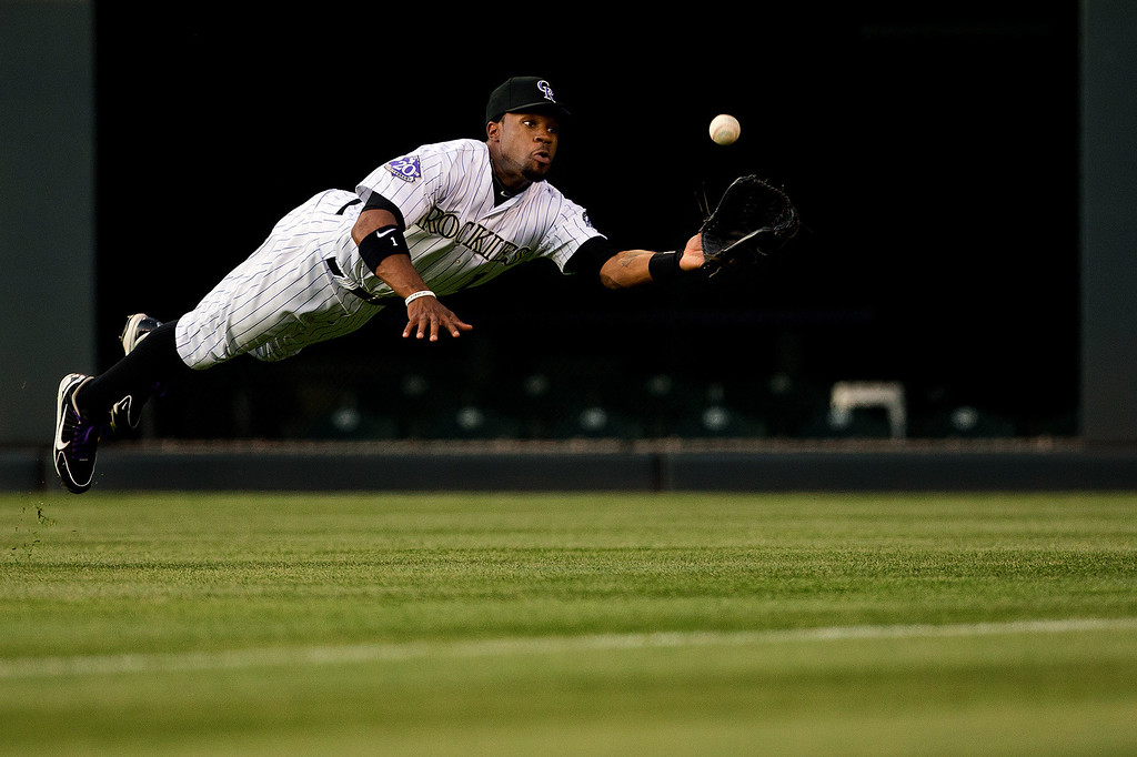 . DENVER, CO - MAY 17:  Right fielder Eric Young Jr. #1 of the Colorado Rockies dives unsuccessfully for a double off the bat of Brett Pill #6 of the San Francisco Giants (not pictured) during the second inning at Coors Field on May 17, 2013 in Denver, Colorado.  (Photo by Justin Edmonds/Getty Images)
