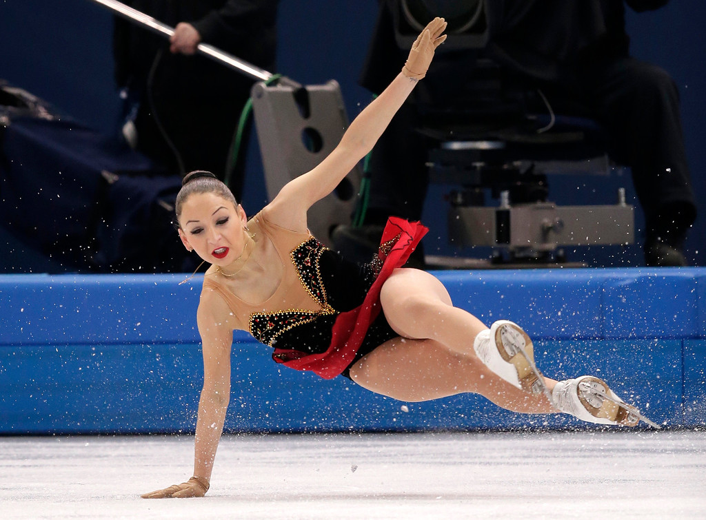 . Elene Gedevanishvili of Georgia falls as she competes in the women\'s free skate figure skating finals at the Iceberg Skating Palace during the 2014 Winter Olympics, Thursday, Feb. 20, 2014, in Sochi, Russia. (AP Photo/Bernat Armangue)