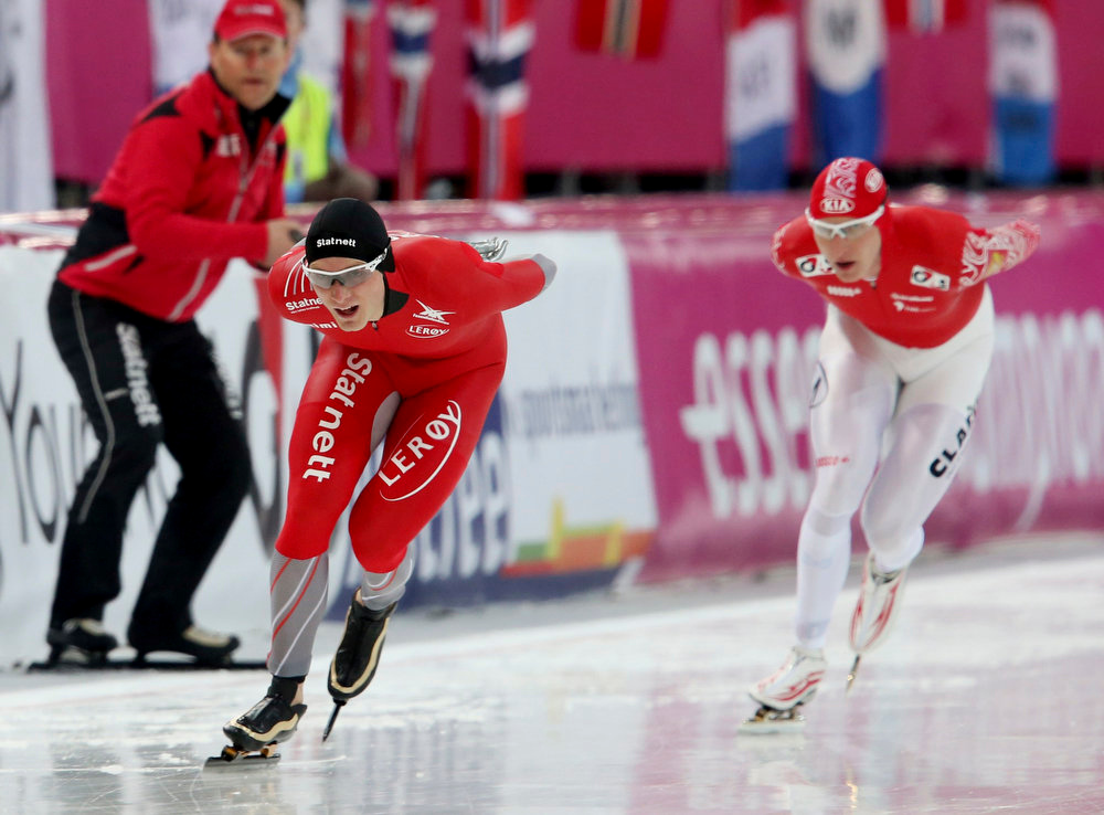 . Havard Boekko of Norway (L) and Ivan Skobrev of Russia skate during the men\'s 5000m event at the World Speedskating Championships in Hamar in this picture provided by NTB Scanpix February 16, 2013. REUTERS/Hakon Mosvold Larsen/NTB Scanpix