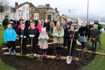 "PUPILS HELP PLANT MAYFLOWER ROSES AT MEMORIAL SITE.Community representatives gathered around a town war memorial site in Dovercourt today to watch pupils from schools in the area plant new shrubs.A special variety of Mayflower Rose had been selected to brighten up the Minesweeper's Memorial in Marine Parade.Tendring District Council (TDC) decided to remove existing flowers - with the approval and backing of Harwich Town Council.Around 60 roses costing about £500 were put in their place by the youngsters from Spring Meadows School, St Josephs, Chase Lane, All Saints Church of England, Harwich Community Primary and Mayflower Primary.The Mayflower is the name of a Harwich ship skippered by town resident Christopher Jones which set sail for America in 1620 with the Pilgrim Fathers on board. Trevor Mills, TDC's Open Space and Transport Manager, said the type of rose was especially selected for its association with Harwich.""The planting all went well and I think the children enjoyed themselves,"" he said.""We were pleased to have them there along with other groups - such as the Mayflower Project – which meant it was a real community activity."" For further information on this press release contact Nigel Brown, Tendring District Council's Communications Manager on 01255 686338.PHOTO Copyright © Maria Fowler 2014"