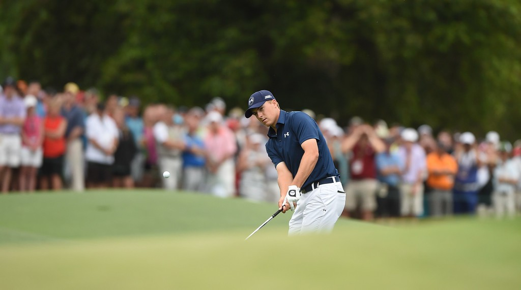 . Jordan Spieth of the US hits a shot on the 8th hole during Round 4 of the 79th Masters Golf Tournament at Augusta National Golf Club on April 12, 2015, in Augusta, Georgia. TIMOTHY A. CLARY/AFP/Getty Images