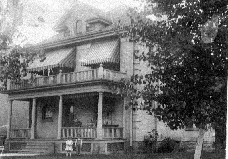 Family Home, 6 S.& 2 E.Grandma Jenkins & Alice Anderson on porch & Mary & Harry Eldredge on lawn