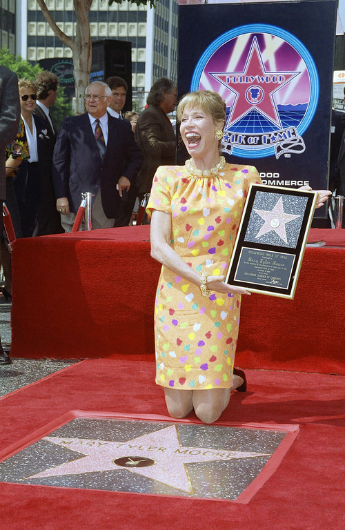 . Actress Mary Tyler Moore reacts to fans and media after being honored with her star on Hollywood?s famed walk, Tuesday, Sept. 8, 1992 in Los Angeles. Moore, who has won five Emmy Awards for her work in ?The Dick Van Dyke Show? and ?The Mary Tyler Moore Show?, was given the 1,963rd star on the famous walk. Moore was also nominated for an Academy Award for her role in ?Ordinary People.? (AP Photo/Chris Martinez)