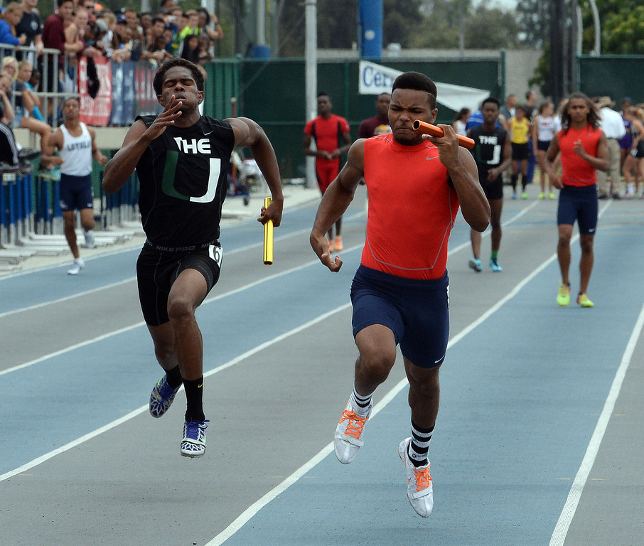 . Upland\'s Mekai Sheffie, left, along with Great Oak\'s Laquan Williams runs the final leg of the division 4 4x100 meter race during the CIF Southern Section track and final Championships at Cerritos College in Norwalk, Calif., Saturday, May 24, 2014.   (Keith Birmingham/Pasadena Star-News)
