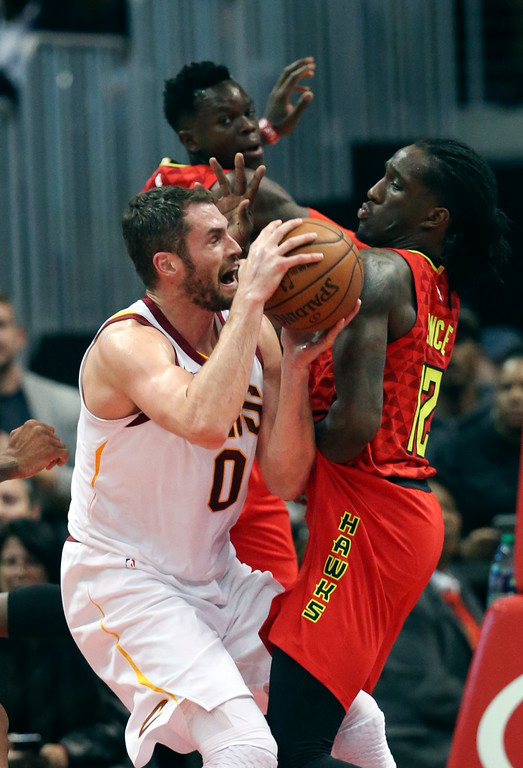 . Cleveland Cavaliers forward Kevin Love (0) battles Atlanta Hawks forward Taurean Prince (12) under  the basket in the first half of an NBA basketball game Thursday, Nov. 30, 2017, in Atlanta. (AP Photo/John Bazemore)