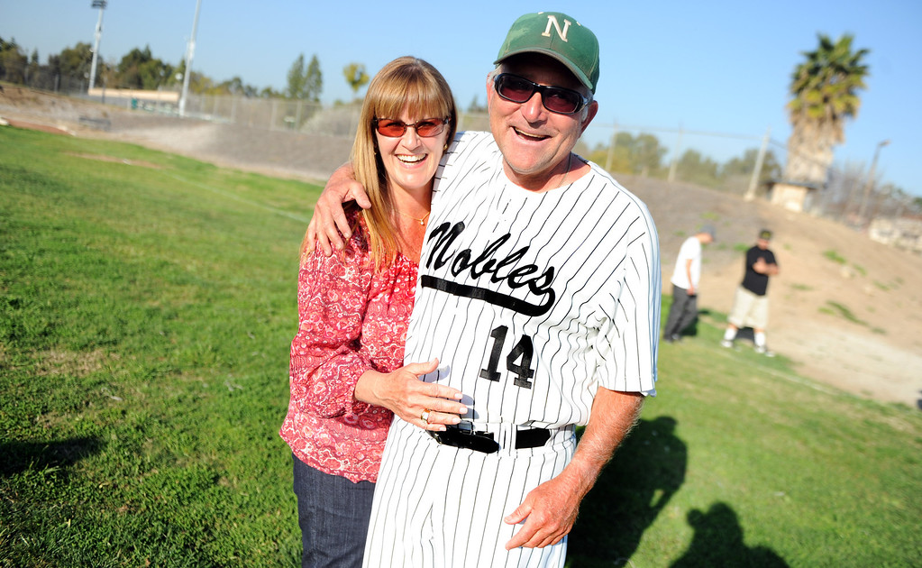 . Nogales coach John Romano (14) poses for a picture with his wife Therese after getting his 600th victory with a 2-0 win over Temple City during a prep baseball game at Nogales High School on Tuesday, March 12, 2013 in West Covina, Calif. Nogales won 2-0.  (Keith Birmingham Pasadena Star-News)