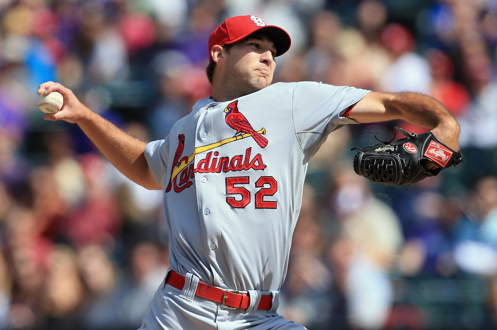 . Starting pitcher Michael Wacha #52 of the St. Louis Cardinals delivers against the Colorado Rockies at Coors Field on September 19, 2013 in Denver, Colorado.  (Photo by Doug Pensinger/Getty Images)