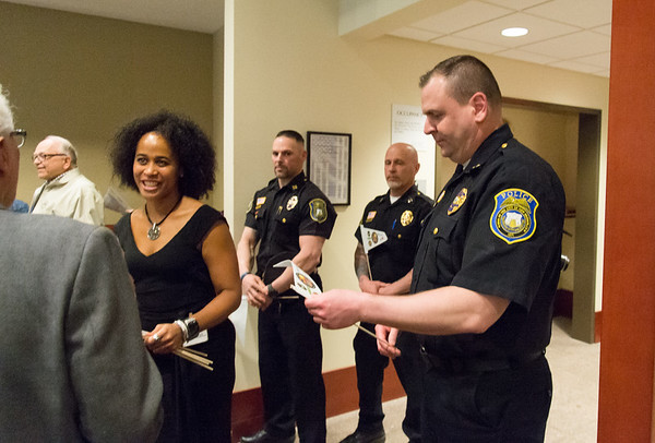 04/08/19 Wesley Bunnell   Staff Police Chief Christopher Chute, R, looks down at a hand out from Marlo Greponne, L, Director of Planning and Programs for HRA, commemorating this week as National Crime Victim's Rights Week. A kick off event was held on Monday afternoon at the New Britain Police Station.