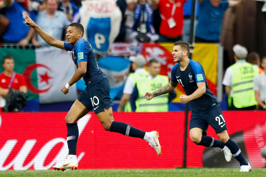 . France\'s Kylian Mbappe, left, celebrates after scoring his side\'s fourth goal with France\'s Lucas Hernandez, right, during the final match between France and Croatia at the 2018 soccer World Cup in the Luzhniki Stadium in Moscow, Russia, Sunday, July 15, 2018. (AP Photo/Matthias Schrader)