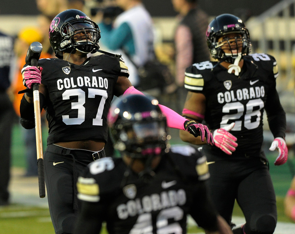 . BOULDER, CO. - OCTOBER 26: Colorado linebacker Woodson Greer III (37) carried a sledgehammer onto the field prior to kickoff.  The University of Colorado football team hosted Arizona Saturday night, October 26, 2013. Photo By Karl Gehring/The Denver Post