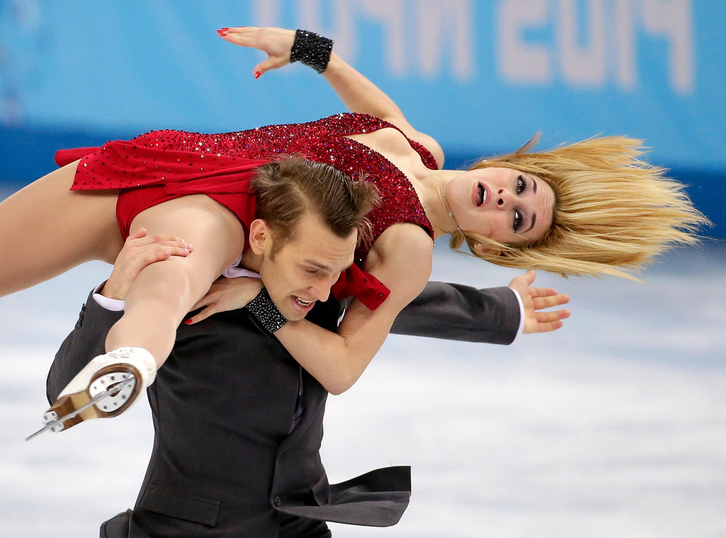 . Isabella Tobias and Deividas Stagniunas of Lithuania compete in the ice dance free dance figure skating finals at the Iceberg Skating Palace during the 2014 Winter Olympics, Monday, Feb. 17, 2014, in Sochi, Russia. (AP Photo/Bernat Armangue)