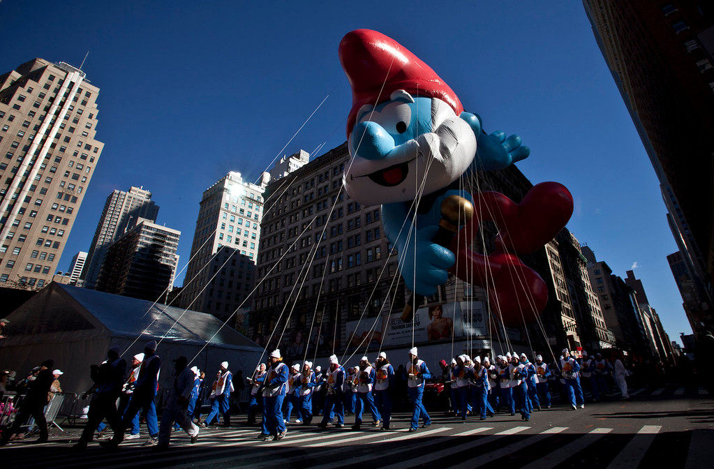 . The Papa Smurf balloon floats above the street during the Macy\'s Thanksgiving Day Parade on November 28, 2013 in New York City. Despite earlier concerns about the wind, the balloons flew as planned for the parade. (Photo by Kena Betancur/Getty Images)