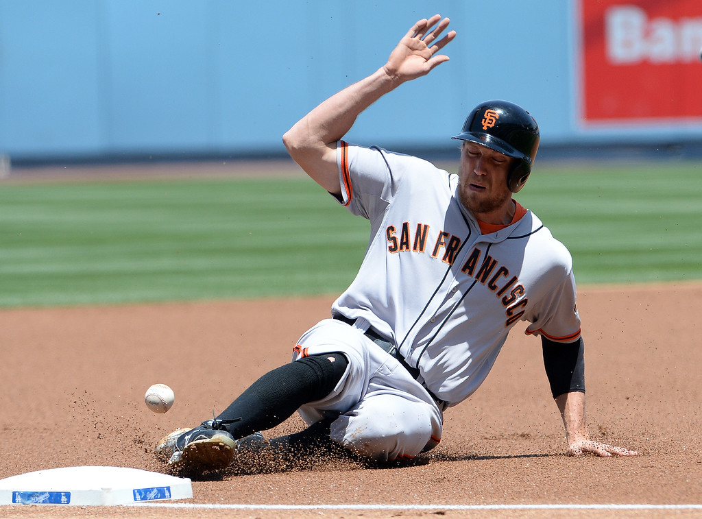 . San Francisco Giants\' Hunter Pence moves to third base on a single by Buster Posey (not pictured) in the first inning of a Major league baseball game against the Los Angeles Dodgers on Saturday, May 10, 2013 in Los Angeles.   (Keith Birmingham/Pasadena Star-News)