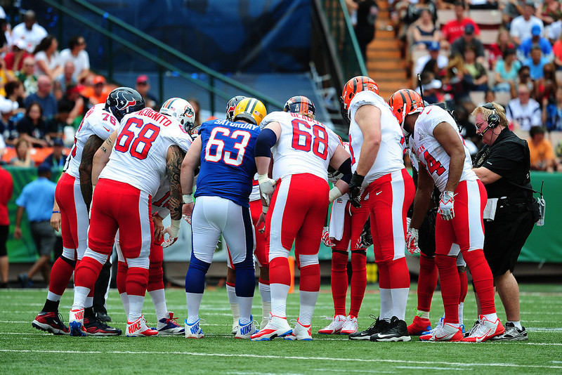 . Jeff Saturday #63 of the Green Bay Packers huddles with the AFC team against the National Football Conference team during the 2013 Pro Bowl at Aloha Stadium on January 27, 2013 in Honolulu, Hawaii  (Photo by Scott Cunningham/Getty Images)