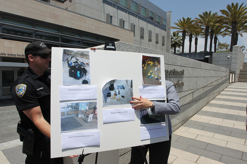. SANTA MONICA, CA - JUNE 08:  Santa Monica Police officials show evidence photos to the press from scenes where of a suspected gunman went on a mass shooting spree until he was shot dead by police at Santa Monica College on June 8, 2013 in Santa Monica, California.    (Photo by David McNew/Getty Images)