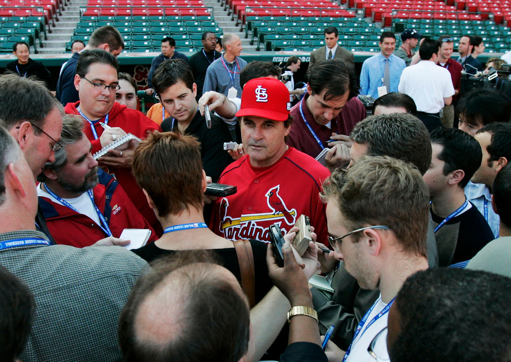 . St. Louis Cardinals manager Tony LaRussa talks to reporters during a workout at Busch Stadium in St. Louis Monday, Oct. 25, 2004. The Cardinals host the Boston Red Sox in Game 3 of the World Series Tuesday night. (AP Photo/Al Behrman)