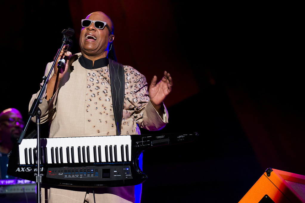 . Stevie Wonder performs at the Global Citizen Festival in Central Park on Saturday, Sept. 28, 2013 in New York. Stevie Wonder gave and electrifying performance at New York\'s Central Park in front of thousands of fans and several world leaders Saturday, singing his hits and calling for an end to poverty worldwide at the Global Citizen Festival. (AP Photo/unite4:good, Charles Sykes/Invision)